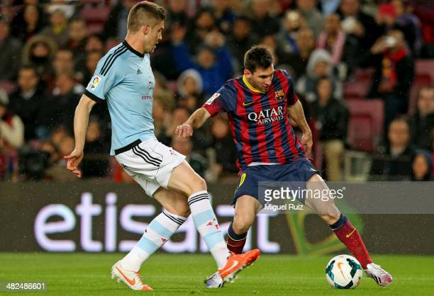 Lionel Messi of FC Barcelona competes for the ball with Andreu Fontas of RC Celta during La Liga match 30 between FC Barcelona and RC Celta at Nou...