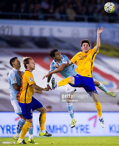 Lionel Messi of FC Barcelona competes for the ball with Augusto Fernandez of Celta Vigo during the La Liga match between Celta Vigo and FC Barcelona...
