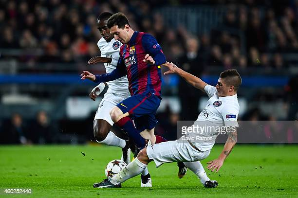 Lionel Messi of FC Barcelona competes for the ball with Blaise Matuidi and Marco Verratti of Paris SaintGermain FC during his team's first goal of FC...