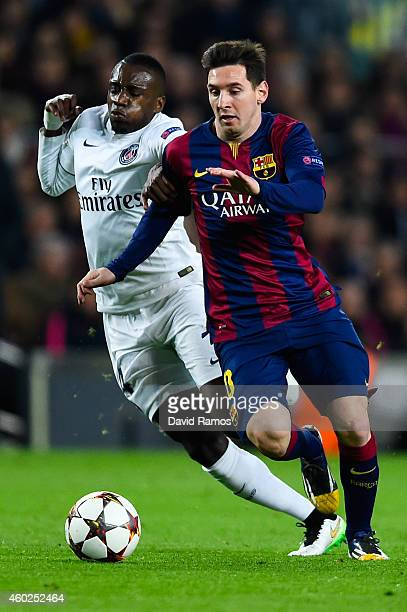 Lionel Messi of FC Barcelona competes for the ball with Blaise Matuidi of Paris SaintGermain FC during his team's first goal of FC Barcelona during...