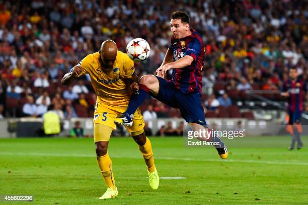 Lionel Messi of FC Barcelona competes for the ball with Carlao of APOEL FC during the UEFA Champions League Group F match between FC Barcelona and...