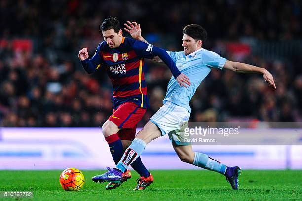 Lionel Messi of FC Barcelona competes for the ball with Carles Planas of RC Celta de Vigo during the La Liga match between FC Barcelona and Celta...