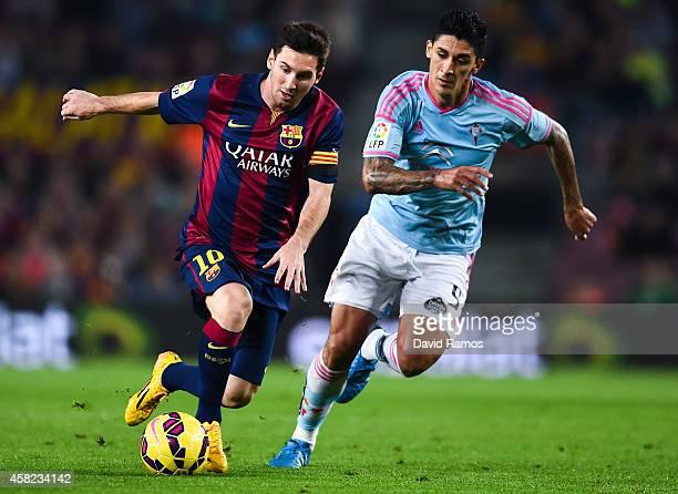 Lionel Messi of FC Barcelona competes for the ball with Charles of Celta de Vigo the La Liga match between FC Barcelona and Celta de Vigo at Camp Nou...