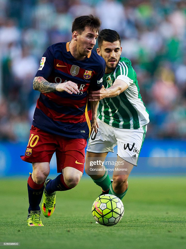 <a gi-track='captionPersonalityLinkClicked' href=/galleries/search?phrase=Lionel+Messi&family=editorial&specificpeople=453305 ng-click='$event.stopPropagation()'>Lionel Messi</a> (L) of FC Barcelona competes for the ball with <a gi-track='captionPersonalityLinkClicked' href=/galleries/search?phrase=Dani+Ceballos&family=editorial&specificpeople=14781637 ng-click='$event.stopPropagation()'>Dani Ceballos</a> (R) of Real Betis Balompie during the La Liga match between Real Betis Balompie and FC Barcelona at Estadio Benito Villamarin on April 30, 2016 in Seville, Spain.