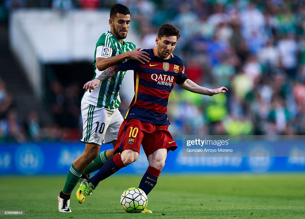 <a gi-track='captionPersonalityLinkClicked' href=/galleries/search?phrase=Lionel+Messi&family=editorial&specificpeople=453305 ng-click='$event.stopPropagation()'>Lionel Messi</a> (R) of FC Barcelona competes for the ball with <a gi-track='captionPersonalityLinkClicked' href=/galleries/search?phrase=Dani+Ceballos&family=editorial&specificpeople=14781637 ng-click='$event.stopPropagation()'>Dani Ceballos</a> (L) of Real Betis Balompie during the La Liga match between Real Betis Balompie and FC Barcelona at Estadio Benito Villamarin on April 30, 2016 in Seville, Spain.