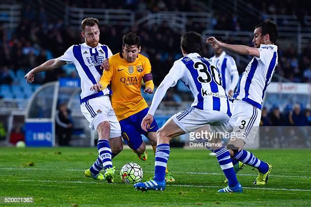 Lionel Messi of FC Barcelona competes for the ball with David Zurutuza Veillet of Real Sociedad during the La Liga match between Real Sociedad de...