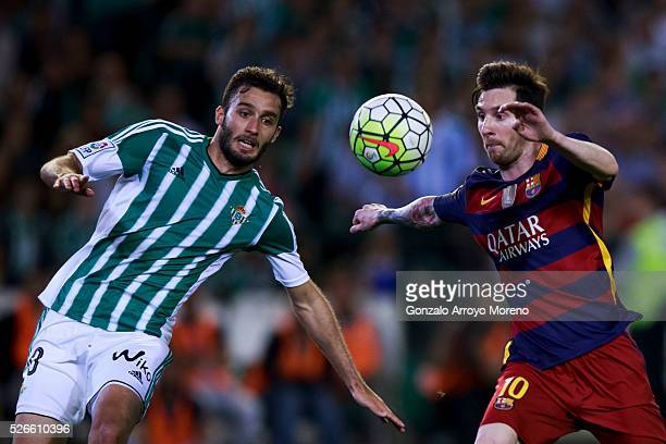 Lionel Messi of FC Barcelona competes for the ball with German Pezzella of Real Betis Balompie during the La Liga match between Real Betis Balompie...