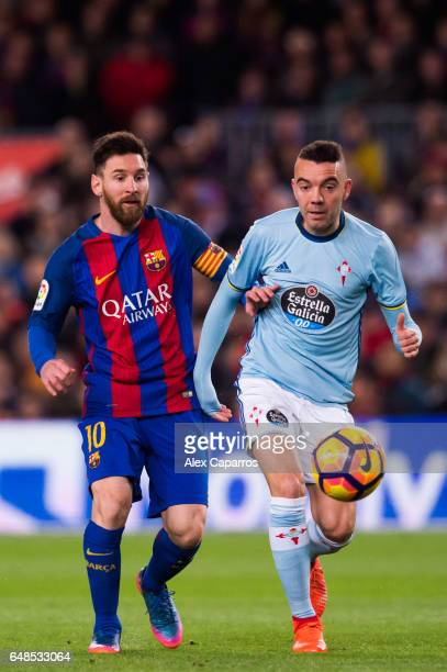 Lionel Messi of FC Barcelona competes for the ball with Iago Aspas of RC Celta de Vigo during the La Liga match between FC Barcelona and RC Celta de...