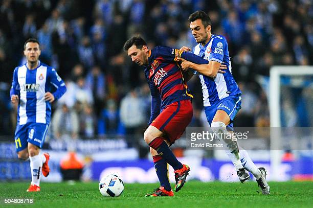 Lionel Messi of FC Barcelona competes for the ball with Jose Jordan of RCD Espanyol the Copa del Rey Round of 16 second leg match between RCD...