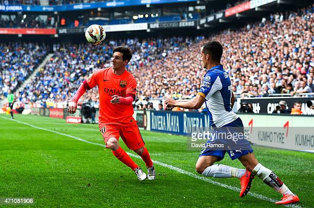 Lionel Messi of FC Barcelona competes for the ball with Lucas Vazquez of RCD Espanyol during the La Liga match between RCD Espanyol and FC Barcelona...