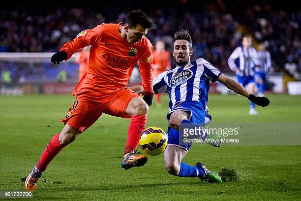 Lionel Messi of FC Barcelona competes for the ball with Luisinho Correia of RC Deportivo La Coruna during the La Liga match between RC Deportivo La...