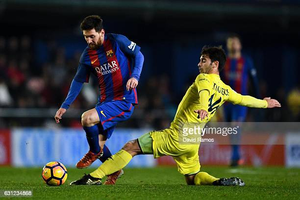Lionel Messi of FC Barcelona competes for the ball with Manu Trigueros of Villarreal CF during the La Liga match between Villarreal CF and FC...