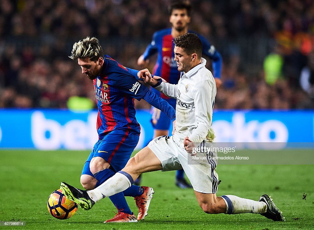 Lionel Messi of FC Barcelona competes for the ball with Mateo Kovacic of Real Madrid CF during La Liga match between FC Barcelona and Real Madrid CF...
