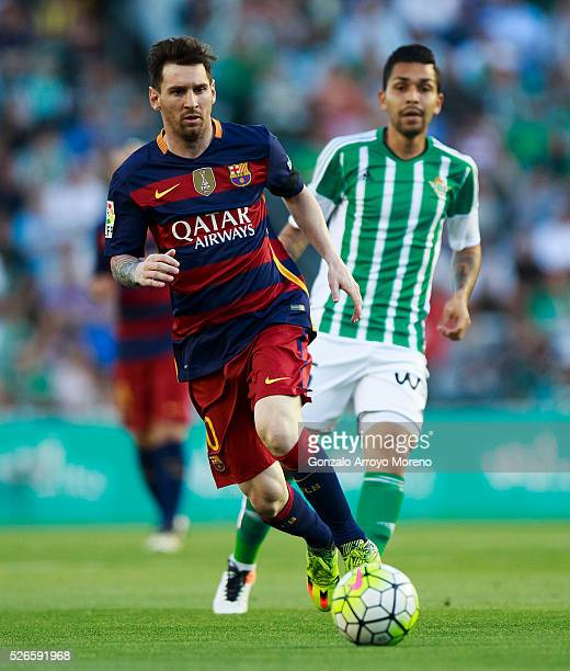 Lionel Messi of FC Barcelona competes for the ball with Petros Matheus of Real Betis Balompie during the La Liga match between Real Betis Balompie...