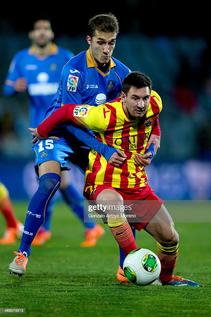 Lionel Messi of FC Barcelona competes for the ball with Rafael Lopez of Getafe CF during the Copa del Rey Round of 8 second leg match between Getafe...