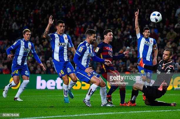 Lionel Messi of FC Barcelona competes for the ball with RCD Espanyol players during the Copa del Rey Round of 16 first leg match between FC Barcelona...