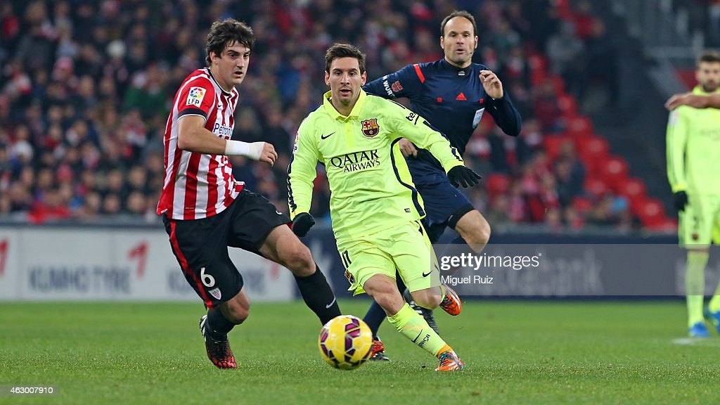Lionel Messi of FC Barcelona competes for the ball with San Jose of Athletic Club during the La Liga match between Athletic Club and FC Barcelona at...