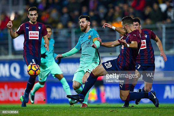 Lionel Messi of FC Barcelona competes for the ball with SD Eibar players during the La Liga match between SD Eibar and FC Barcelona at Ipurua stadium...