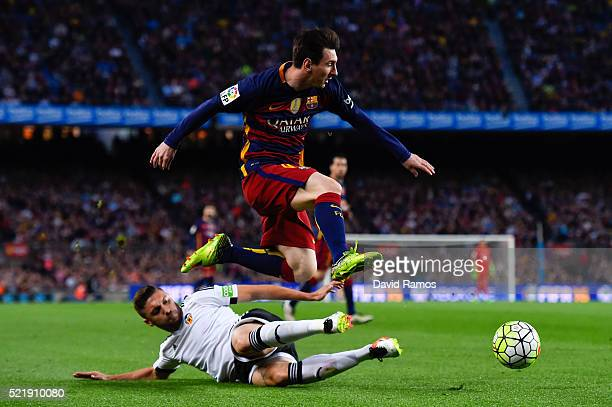 Lionel Messi of FC Barcelona competes for the ball with Shkodran Mustafi of Valencia CF during the La Liga match between FC Barcelona and Valencia CF...