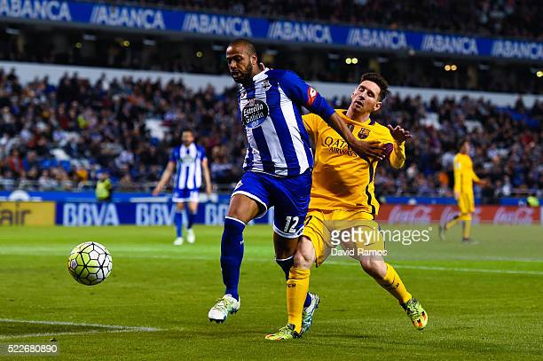 Lionel Messi of FC Barcelona competes for the ball with Sidnei Rechel da Silva of RC Deportivo La Coruna during the La Liga match between RC...