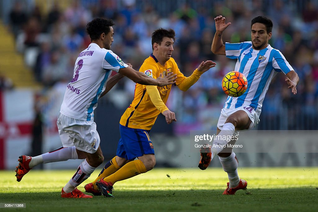 Lionel Messi of FC Barcelona competes for the ball with Weligton Robson of Malaga CF and his teammate Jose Luis Garcia alias Recio during the La Liga...