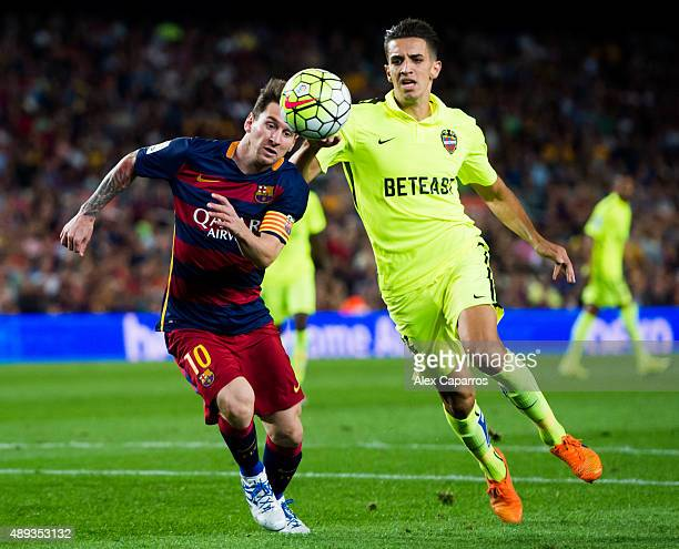 Lionel Messi of FC Barcelona competes for the ball with Zouhair 'Zou' Feddal during the La Liga match between FC Barcelona and Levante UD at Camp Nou...