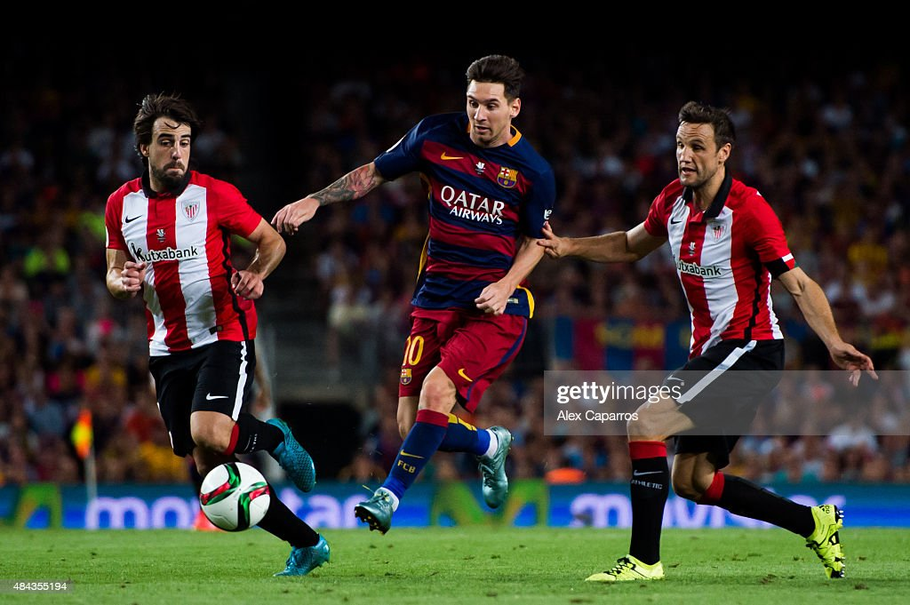 <a gi-track='captionPersonalityLinkClicked' href=/galleries/search?phrase=Lionel+Messi&family=editorial&specificpeople=453305 ng-click='$event.stopPropagation()'>Lionel Messi</a> (C) of FC Barcelona controls the ball between <a gi-track='captionPersonalityLinkClicked' href=/galleries/search?phrase=Benat+Etxebarria&family=editorial&specificpeople=8282511 ng-click='$event.stopPropagation()'>Benat Etxebarria</a> (L) and Carlos Gurpegi (R) of Athletic Club during the Spanish Super Cup second leg match between FC Barcelona and Athletic Club at Camp Nou on August 17, 2015 in Barcelona, Spain.