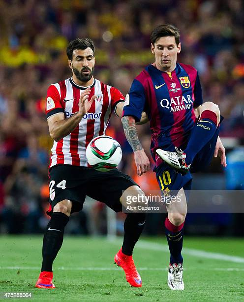 Lionel Messi of FC Barcelona controls the ball next to Mikel Balenziaga of Athletic Club during the Copa del Rey Final between Athletic Club and FC...