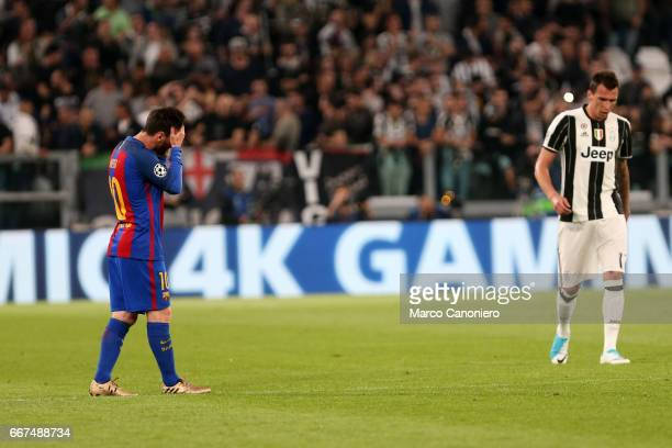 Lionel Messi of Fc Barcelona disappointed after Dybala's goal during the UEFA Champions League quarter final first leg match between Juventus FC and...
