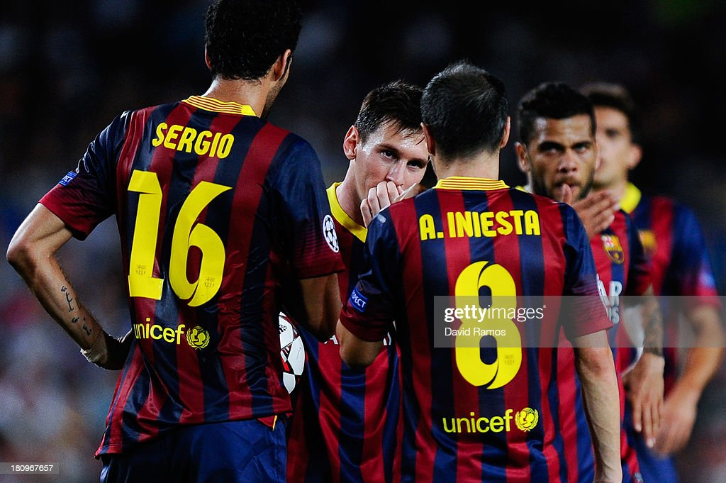 Lionel Messi of FC Barcelona discusses the strategy with his team-mates before a free-kick during the UEFA Champions League Group H match between FC Barcelona and Ajax Amsterdam ag the Camp Nou stadium on September 18, 2013 in Barcelona, Spain.