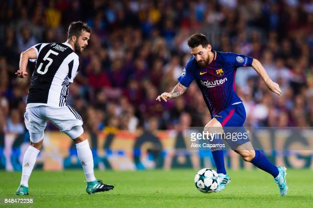 Lionel Messi of FC Barcelona dribbles Miralem Pjanic of Juventus during the UEFA Champions League group D match between FC Barcelona and Juventus at...