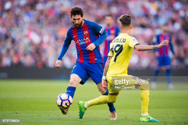 Lionel Messi of FC Barcelona dribbles Samu Castillejo of Villarreal CF during the La Liga match between FC Barcelona and Villarreal CF at Camp Nou...