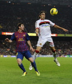 Lionel Messi of FC Barcelona duels for a high ball with Jose Manuel Flores 'Chico' of RCD Mallorca during the La Lliga match between FC Barcelona and...