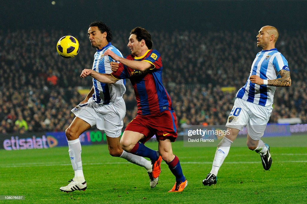 <a gi-track='captionPersonalityLinkClicked' href=/galleries/search?phrase=Lionel+Messi&family=editorial&specificpeople=453305 ng-click='$event.stopPropagation()'>Lionel Messi</a> of FC Barcelona (C) duels for the ball for the ball against Weligton of Malaga (L) during the La Liga match between FC Barcelona and Malaga at Nou Camp on January 16, 2011 in Barcelona, Spain. Barcelona won 4-1.