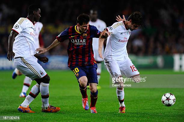 Lionel Messi of FC Barcelona duels for the ball with Andrea Poli and Cristian Zapata of AC Milan during the UEFA Champions League Group H match...