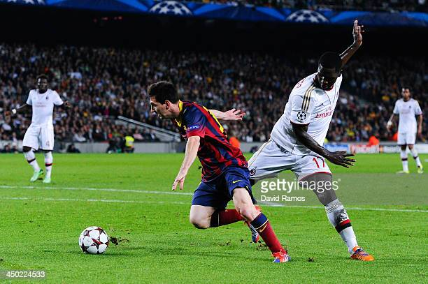 Lionel Messi of FC Barcelona duels for the ball with Cristian Zapata of AC Milan the UEFA Champions League Group H match Between FC Barcelona and AC...