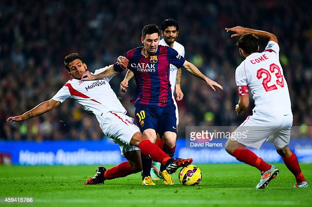 Lionel Messi of FC Barcelona duels for the ball with Daniel Filipe Martins Carrico and Jorge Andujar Moreno 'Coke' of Sevilla FC of Sevilla FCat Camp...