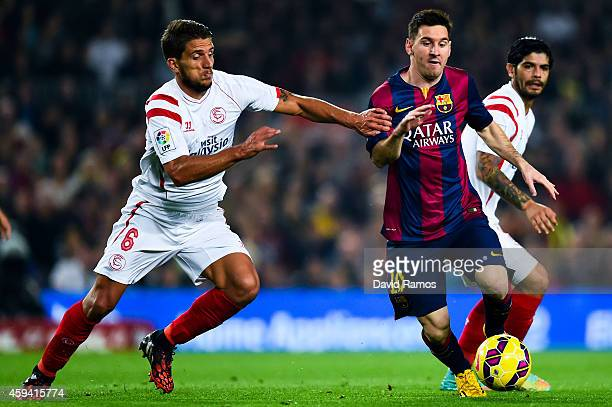 Lionel Messi of FC Barcelona duels for the ball with Daniel Filipe Martins Carrico of Sevilla FC of Sevilla FCat Camp Nou on November 22 2014 in...