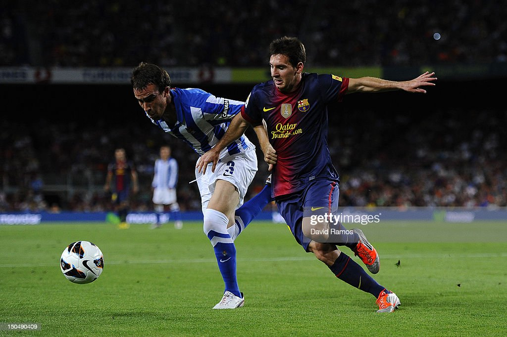 Lionel Messi of FC Barcelona duels for the ball with Ion Mikel Gonzalez Martinez of Real Sociedad de Futbol during the La Liga match between FC...
