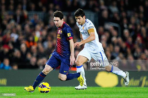 Lionel Messi of FC Barcelona duels for the ball with Javier Paredes of Real Zaragoza during the La Liga match between FC Barcelona and Real Zaragoza...