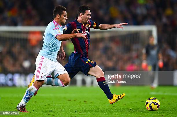 Lionel Messi of FC Barcelona duels for the ball with Jonny of Celta de Vigo during the La Liga match between FC Barcelona and Celta de Vigo at Camp...