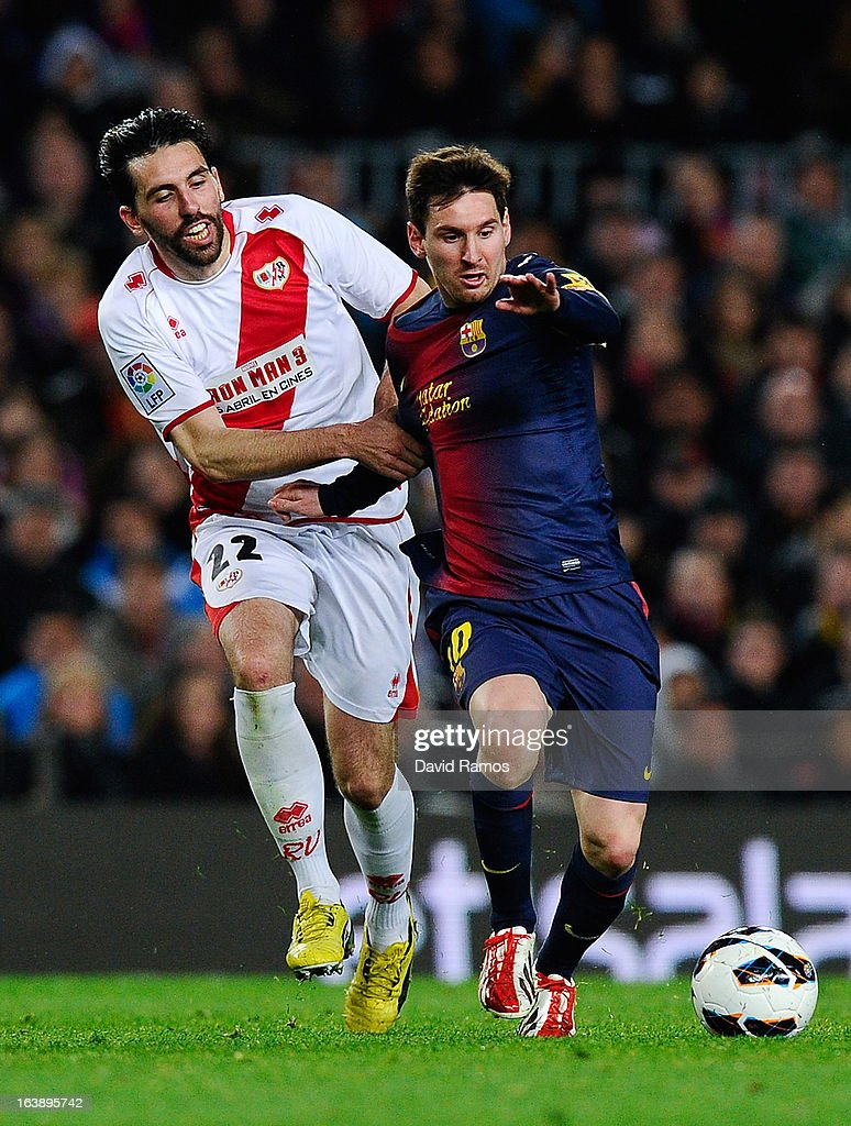 <a gi-track='captionPersonalityLinkClicked' href=/galleries/search?phrase=Lionel+Messi&family=editorial&specificpeople=453305 ng-click='$event.stopPropagation()'>Lionel Messi</a> of FC Barcelona duels for the ball with Jordi Figueras of Rayo Vallecano during the La Liga match between FC Barcelona and Rayo Vallecano at Camp Nou on March 17, 2013 in Barcelona, Spain.