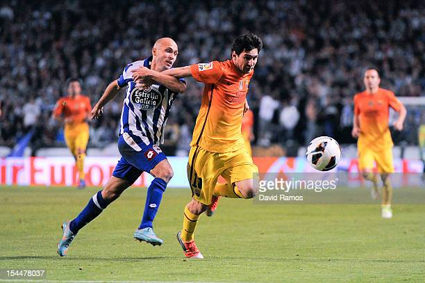 Lionel Messi of FC Barcelona duels for the ball with Laureano Sanabria of Deportivo La Coruna during the La Liga match between Deportivo La Coruna...