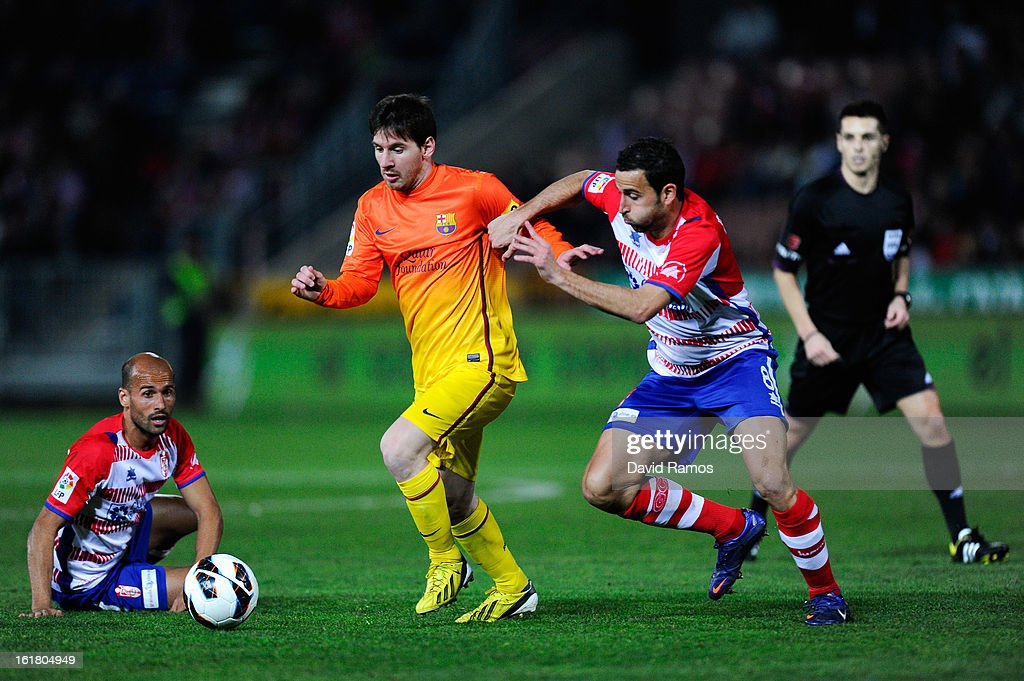 <a gi-track='captionPersonalityLinkClicked' href=/galleries/search?phrase=Lionel+Messi&family=editorial&specificpeople=453305 ng-click='$event.stopPropagation()'>Lionel Messi</a> of FC Barcelona duels for the ball with Mikel Rico (L) and Inigo Lopez of Granada CF during the La Liga match between Granada CF and FC Barcelona at Estadio Nuevo Los Carmenes on February 16, 2013 in Granada, Spain.