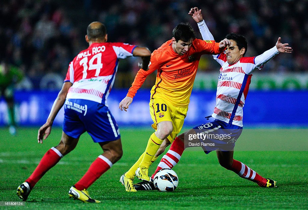 <a gi-track='captionPersonalityLinkClicked' href=/galleries/search?phrase=Lionel+Messi&family=editorial&specificpeople=453305 ng-click='$event.stopPropagation()'>Lionel Messi</a> of FC Barcelona duels for the ball with Mikel Rico (L) and Jose Luis Garcia 'Recio' of Granada CF during the La Liga match between Granada CF and FC Barcelona at Estadio Nuevo Los Carmenes on February 16, 2013 in Granada, Spain.
