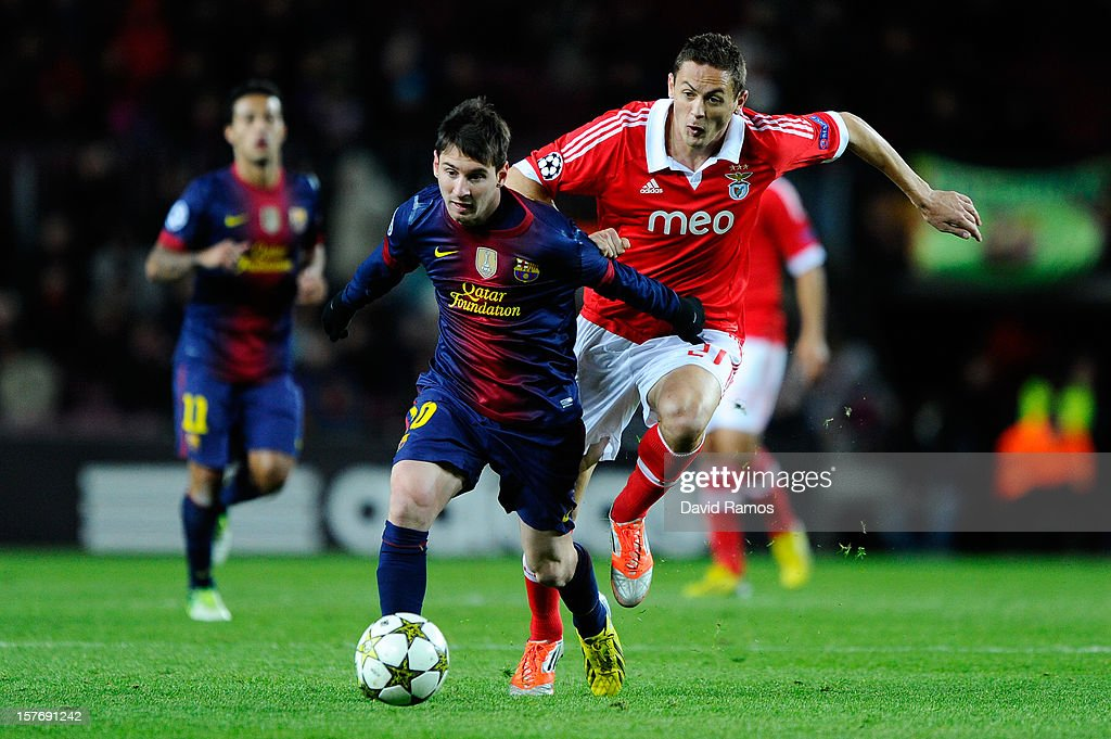 Lionel Messi of FC Barcelona duels for the ball with Nemanja Matic of SL Benfica during the UEFA Champions League Group G match between FC Barcelona and SL Benfica at Nou Camp on December 5, 2012 in Barcelona, Spain.