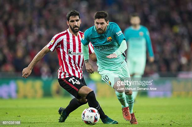 Lionel Messi of FC Barcelona duels for the ball with Raul Garcia of Athletic Club during the Copa del Rey Round of 16 first leg match between...