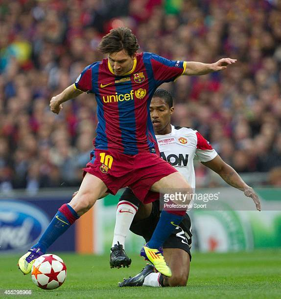 Lionel Messi of FC Barcelona evades Antonio Valencia of Manchester United during the UEFA Champions League final between FC Barcelona and Manchester...