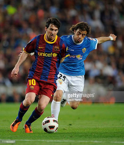 Lionel Messi of FC Barcelona fights for the ball against Hernan Bernardello of Almeria during the La Liga match between FC Barcelona and UD Almeria...