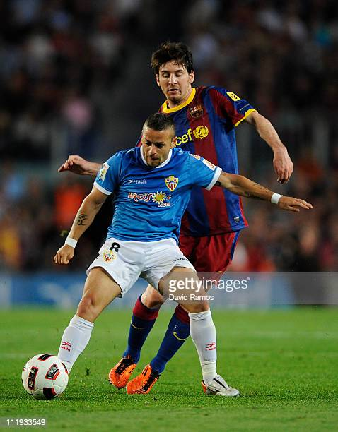 Lionel Messi of FC Barcelona fights for the ball againstAlbert Crusat Domene of Almeria during the La Liga match between FC Barcelona and UD Almeria...